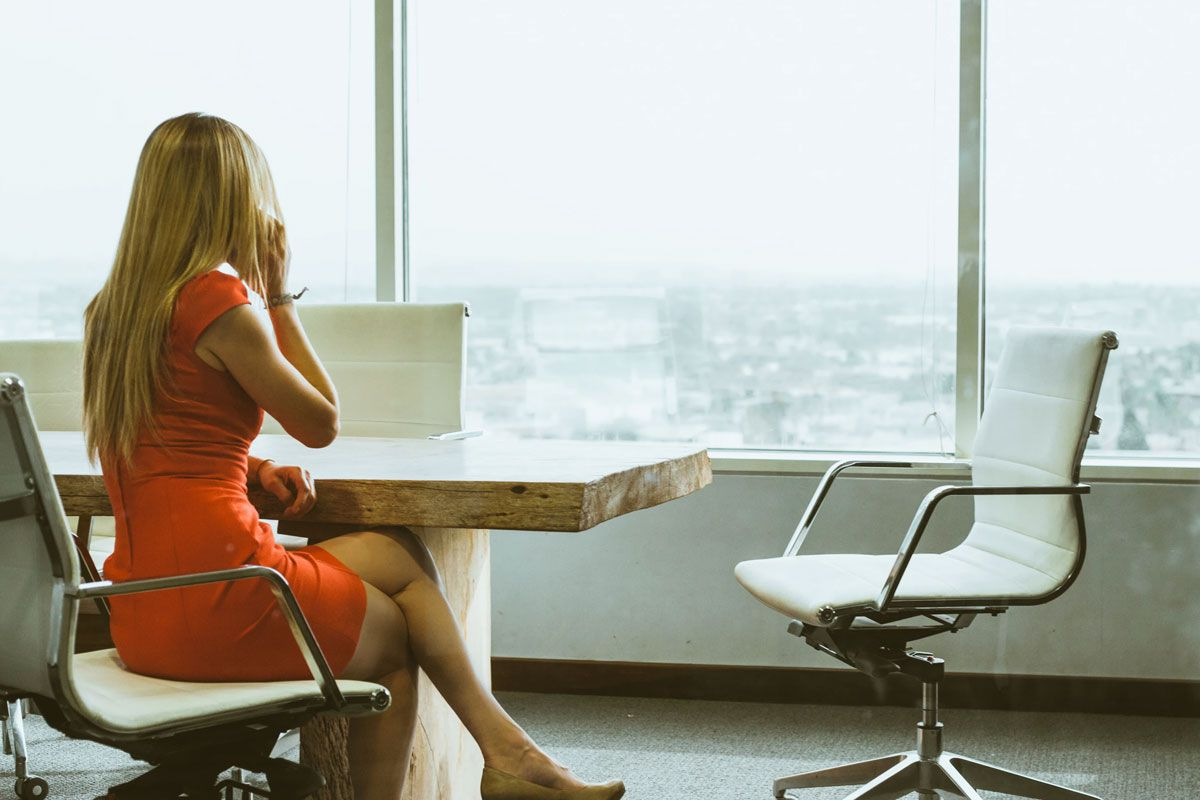 Woman At A Desk